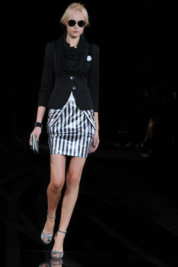 An Emporio Armani model shows one way to wear  the trend  — a skirt. Photo: GIUSEPPE CACACE, AFP/Getty Images