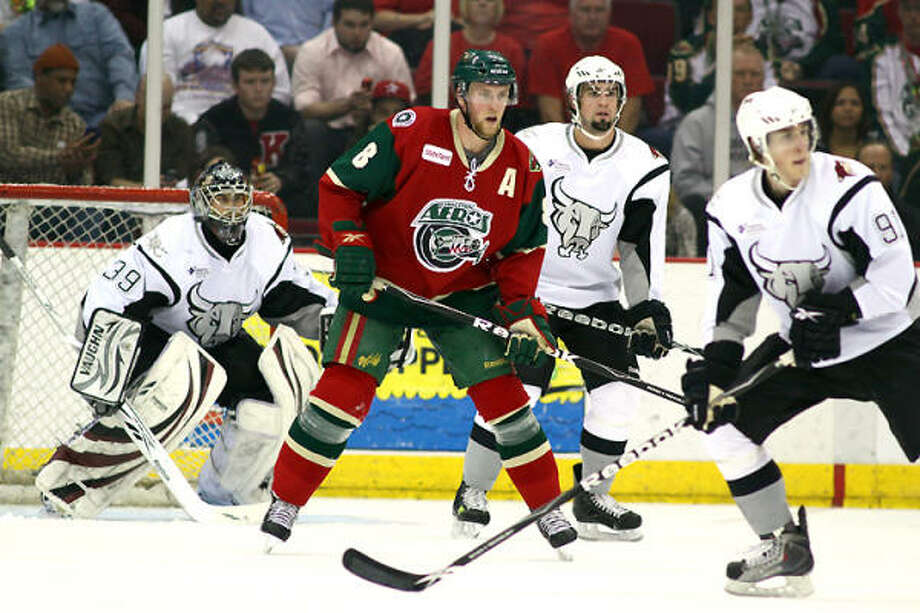 Nathan Smith, second from left, scored twice in the Aeros' 3-1 win over the Rampage on Friday. Photo: Jason Villanueva