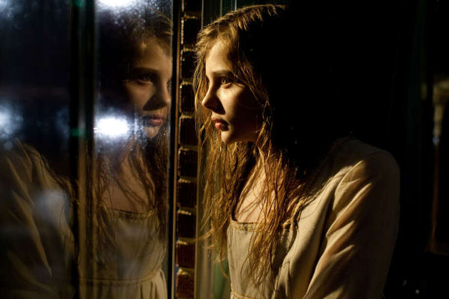 Abby (Chloë Grace Moretz) has a deadly secret in Let Me In. Photo: Saeed Adyani