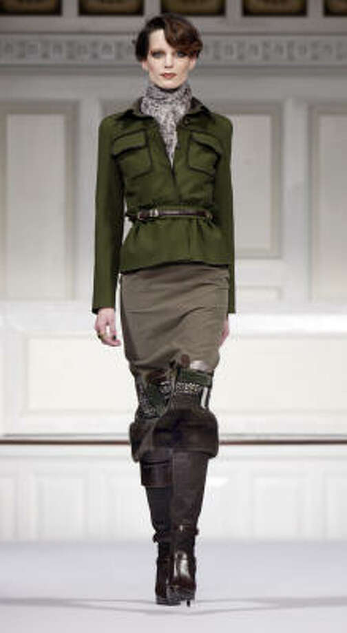 Oscar de la Renta rolls out a military jacket for 2010. Photo: Richard Drew, AP