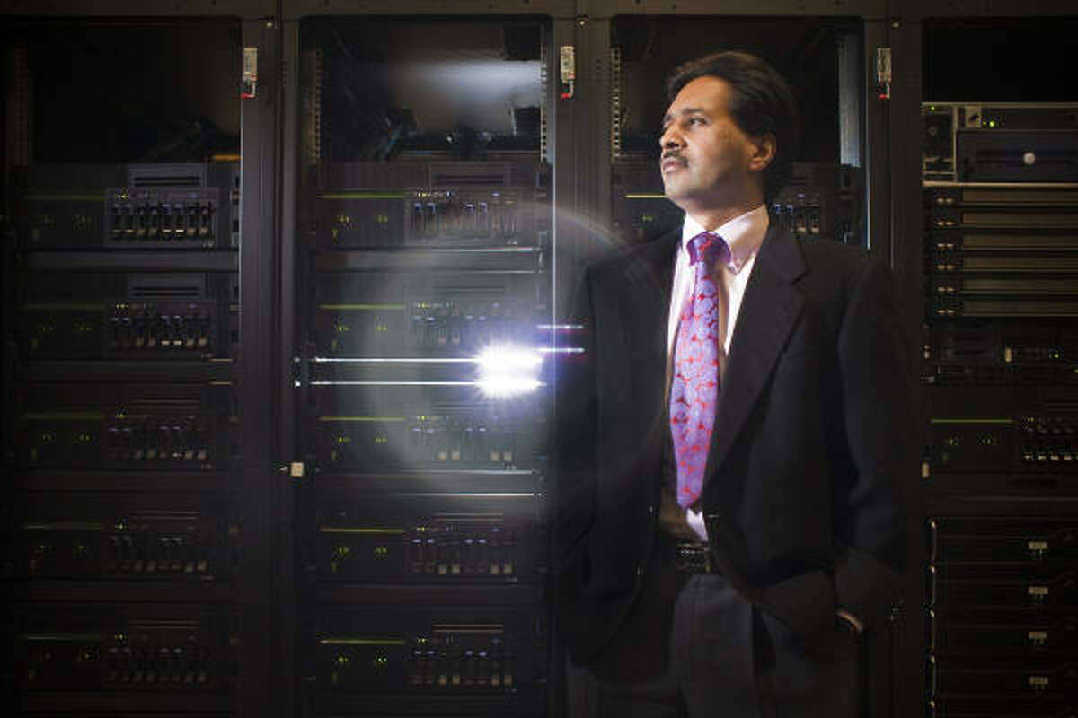 Vivek Sarkar, Ph.D., stands near a $7.6 million IBM supercomputer donated to Rice University that effectively doubles the university's supercomputing capacity.