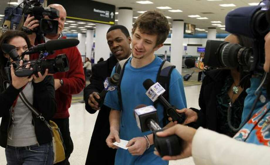 Reporters surround freed American Silas Thompson, 19, of Twin Falls, Idaho, as he prepares to leave Miami's airport on  Thursday.He plans to head to Topeka, Kan. Photo: J. Pat Carter, Associated Press