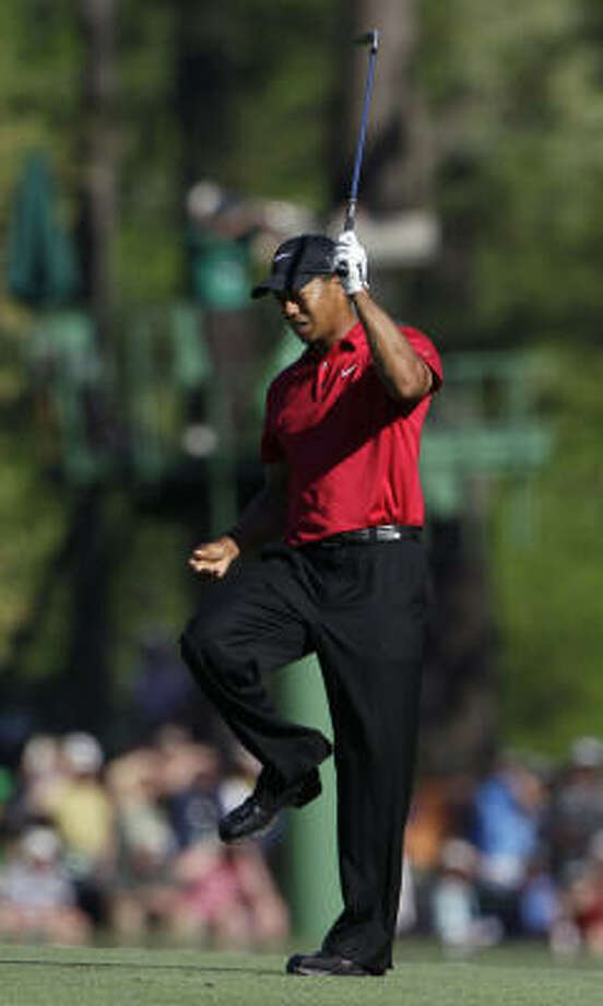 An errant approach on No. 13 was one of many shots that upset Tiger Woods on Sunday. Photo: Charlie Riedel, AP