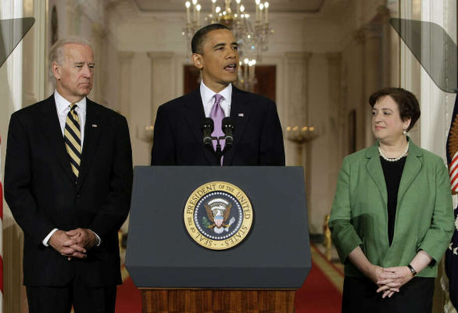 President Barack Obama introduces Solicitor General Elena Kagan as his choice for Supreme Court Justice in the East Room of the White House in Washington, Monday May 10, 2010 as Vice President Joe Biden listens. (AP Photo/J. Scott Applewhite) Photo: J. Scott Applewhite, AP