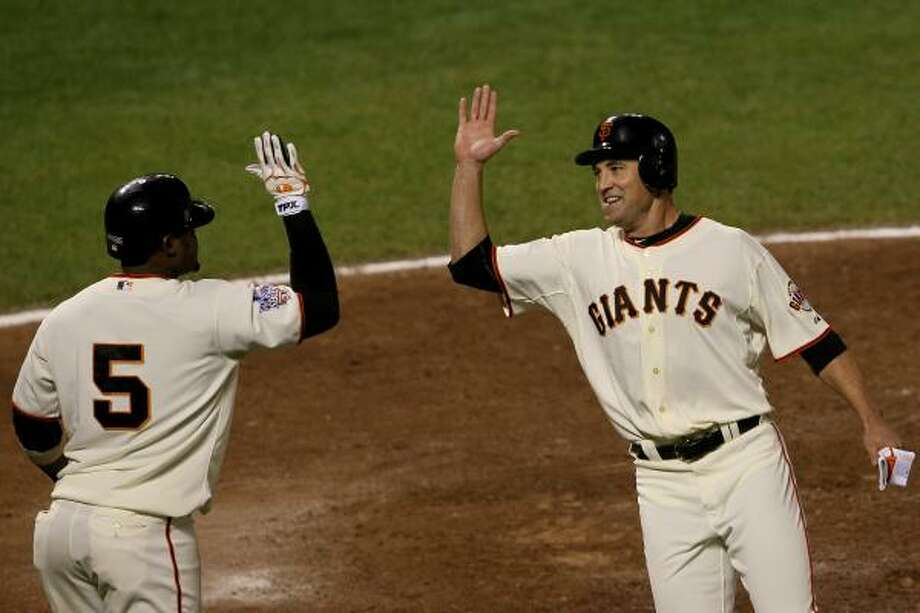 Pat Burrell, right, is one of the players whose future was uncertain before getting a call from the Giants. Photo: Justin Sullivan, Getty Images