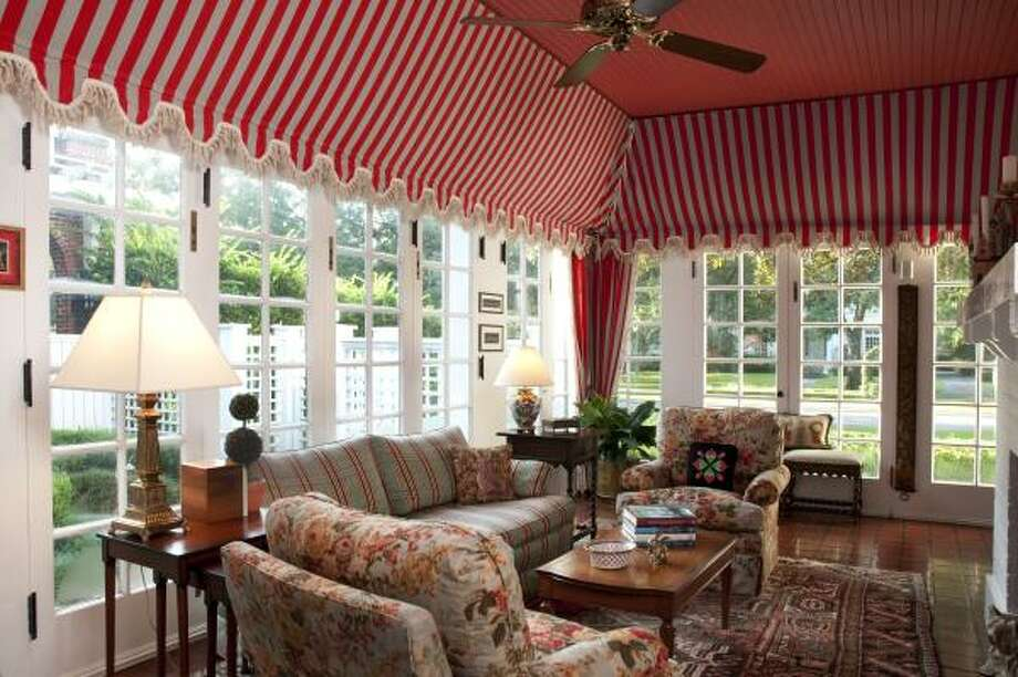 Sunrooms were a must-have when Courtlandt Place was built. The cheerful sunroom at No. 22, one of seven homes on this year's Courtlandt Place Home Tour, is genteel but not fussy. The awnings were installed by a previous owner. Photo: Don Glentzer