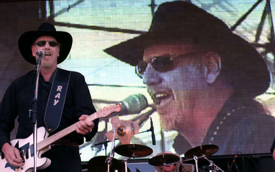 Asleep at the Wheel frontman Ray Benson belts out a song during a performance at the George Strait Music Festival in 1999. Photo: File Photo