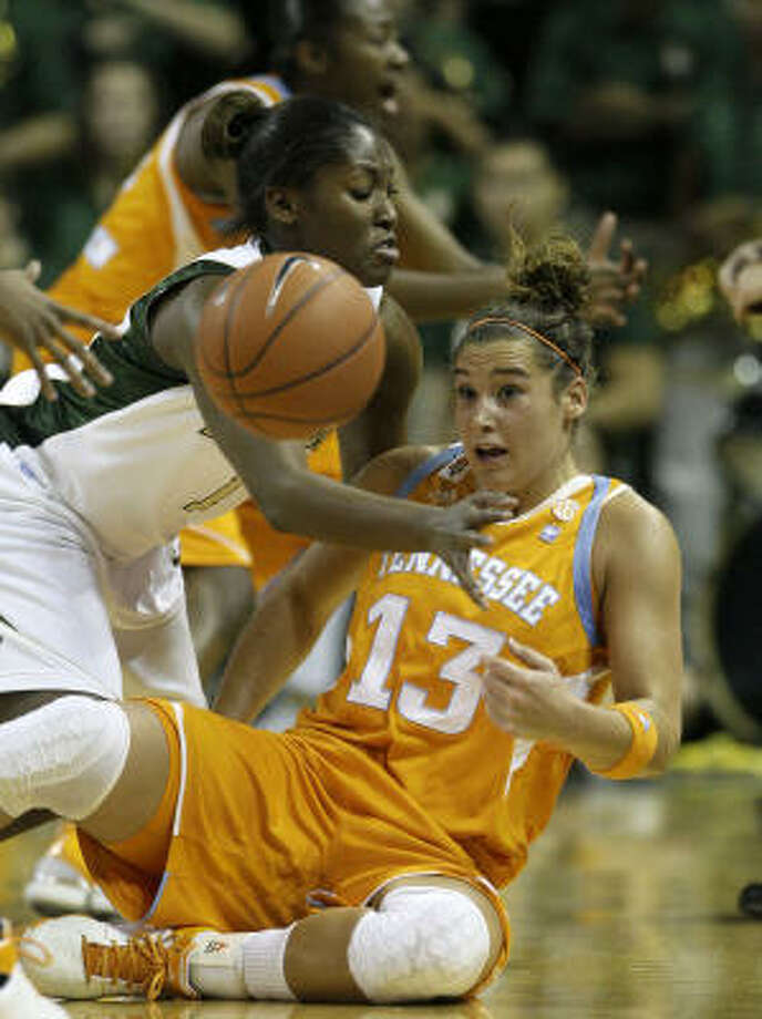 Tennessee guard Taber Spani (13) flips a ball to a teammate as Baylor guard Kimetria Hayden, left, defends in Baylor's  65-54 win. Photo: AP