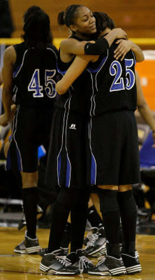 Dekaney's Shunta Nevitt, left, and Lexy Harris celebrate the victory over The Woodlands. Photo: Melissa Phillip, Chronicle