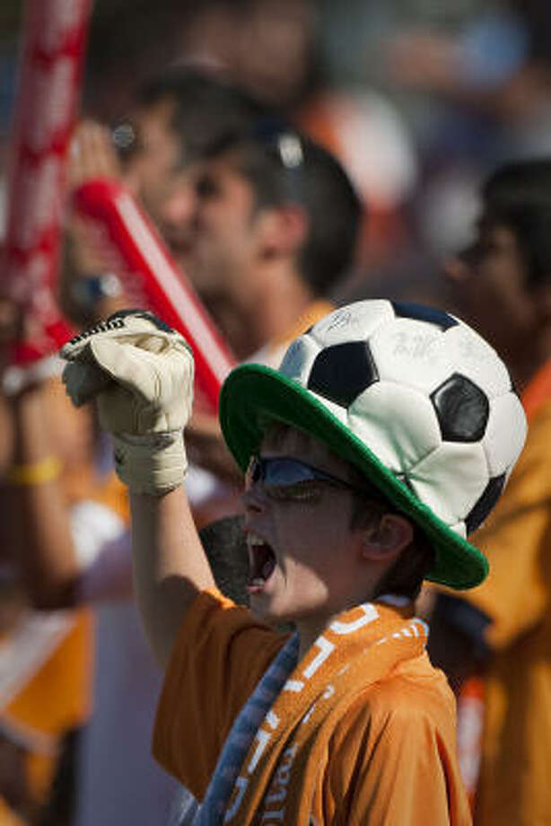 With a couple of promotions geared toward helping make games and food affordable, Dynamo fans like this one have plenty to cheer about heading into the season. Photo: Smiley N. Pool, Chronicle