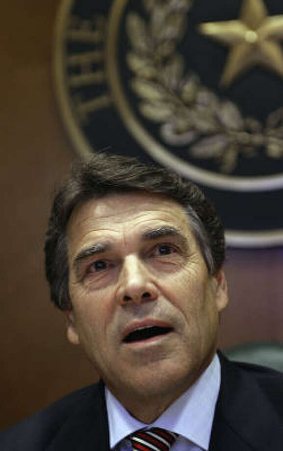 Gov. Rick Perry will have surgery to repair a torn meniscus in his left knee. An avid jogger, he had the same procedure done to his right knee in 2001. Photo: Harry Cabluck, AP