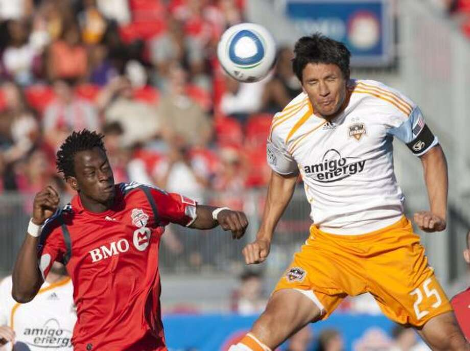 Brian Ching experienced the negative side of soccer fever while playing away games. Photo: Chris Young, AP