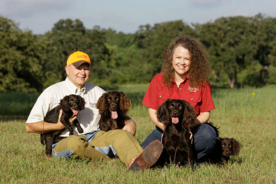 Greg and Michelle Copeland show some Boykin spaniels, Cami, from left, Inde, Mattie and Tea, at the Texas Trace Kennel and Ranch in Hempstead. Photo: Melissa Phillip, Chronicle