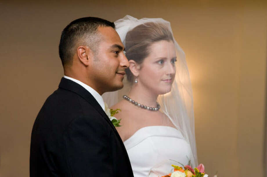 Wharton Fire Department Capt. Thomas Araguz III and his wife, Nikki Araguz, during their wedding in August 2008. He died in a fire this month. Photo: Courtesy Of Cara Dubcak