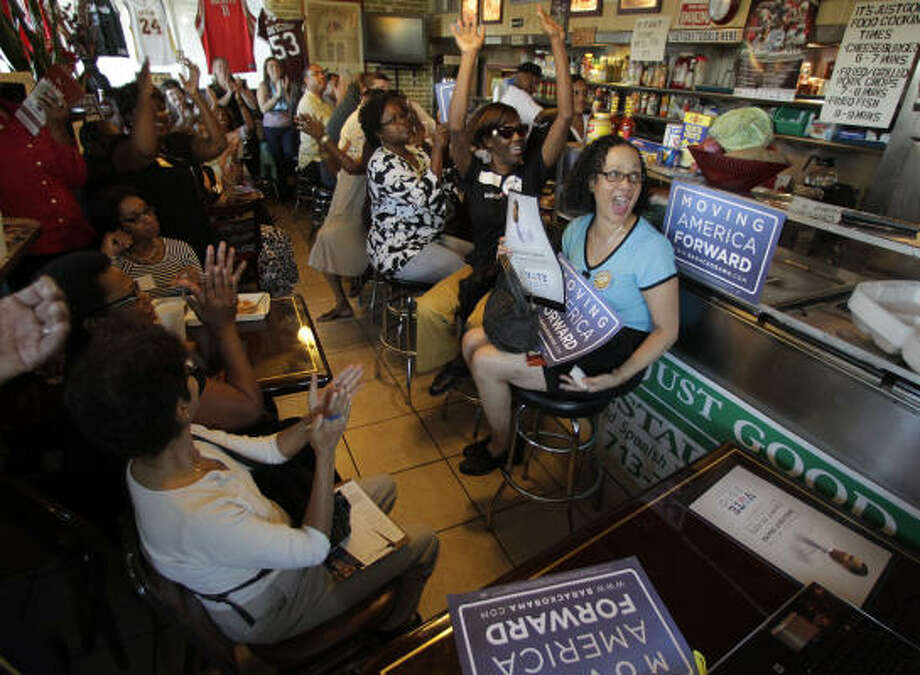 Despite an increase of Republican-leaning voters, spirits are high as attendees get ready to listen as President Barack Obama speaks via an Organizing for America online event Tuesday at It's Just Good soul food restaurant on Old Spanish Trail. Photo: Karen Warren, Chronicle