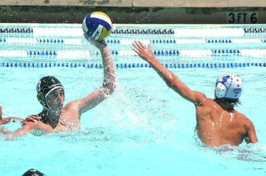 Greenwich Water Polo's Mack Neary firing a shot over an 680 Red defender Tuesday in California. Photo: Contributed Photo