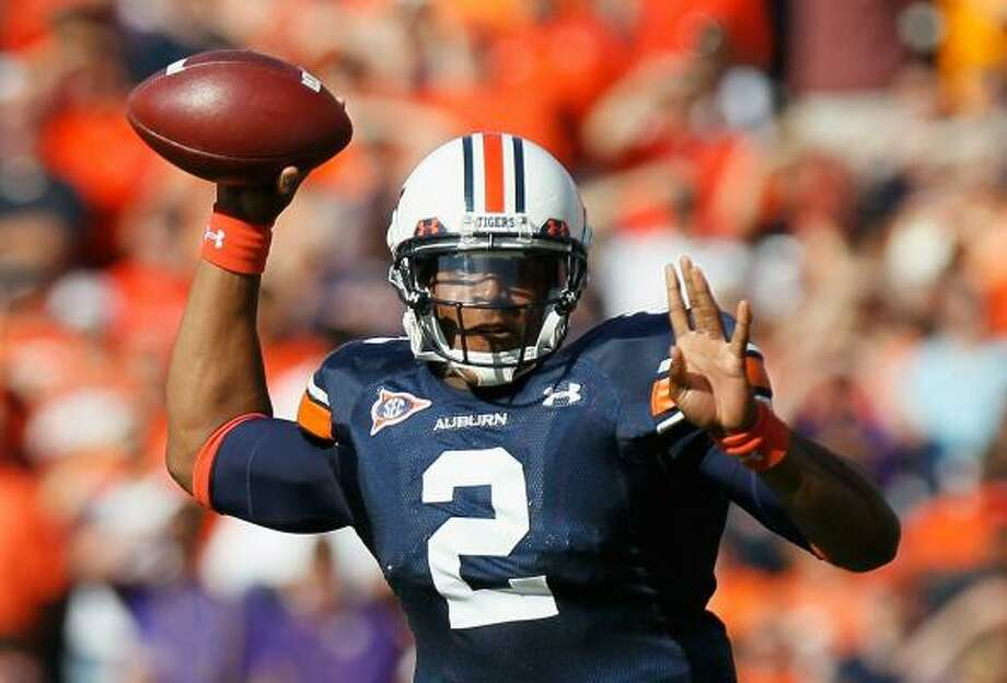 Auburn quarterback Cameron Newton used his legs more than his arm, passing for just 86 yards in Saturday's win over LSU. Photo: Kevin C. Cox, Getty Images