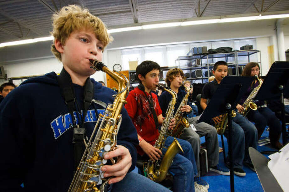 Hamilton Middle School students Benjamin Flannery, left, Stephen Garza, Wes Gil, Brandon Pallares and Victoria Simerskey practice on their alto saxophones. Photo: Christopher Patronella, Jr., Chronicle