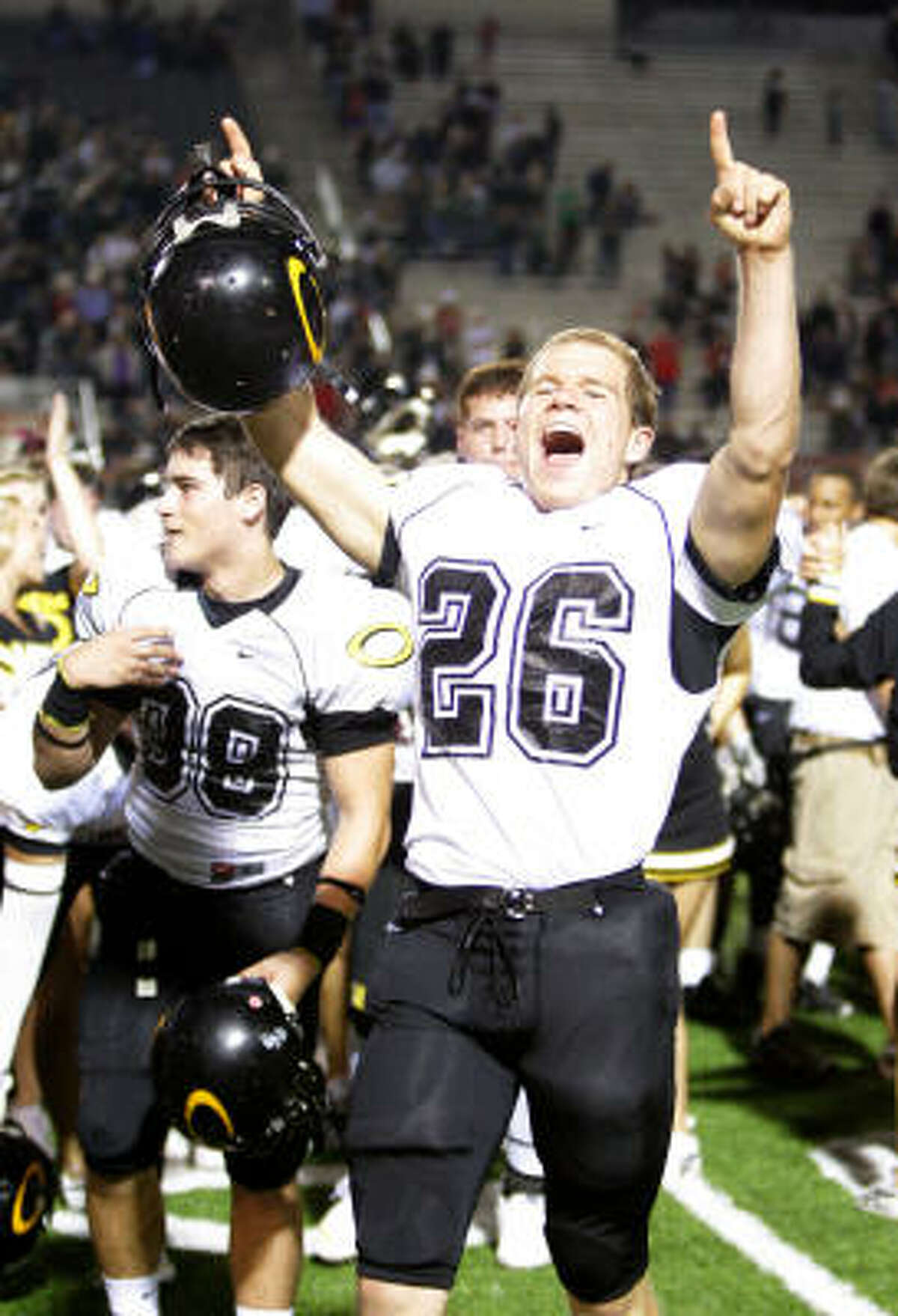Klein Oak's Josh Redkey celebrates on the field after the win over The Woodlands on Friday night.