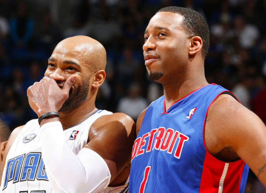Tracy McGrady, shown here sharing a laugh with cousin Vince Carter, hasn't had much to smile about this season. Photo: Gary W. Green, MCT