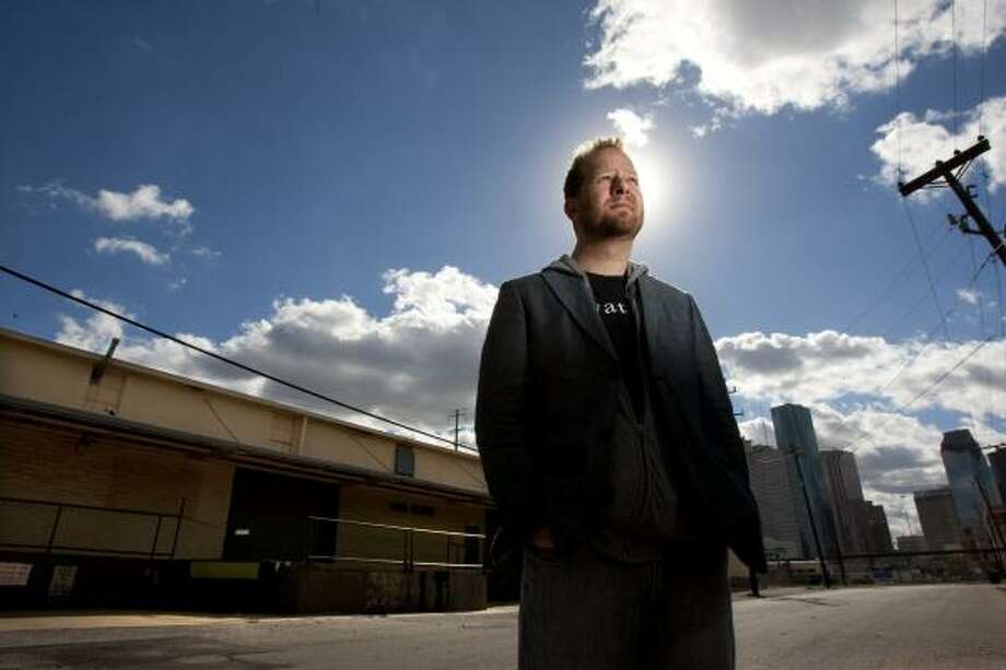 Ecclesia Church pastor Chris Seay stands next to the First Ward warehouse property the Montrose neighborhood church recently purchased. Photo: Johnny Hanson, Chronicle