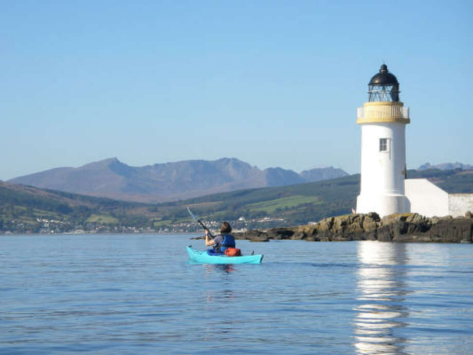 Kayakers can enjoy the solitude in the waters off Scotland's Isle of Arran. Photo: CALUM MCNICOL, ARRAN ADVENTURE CO.