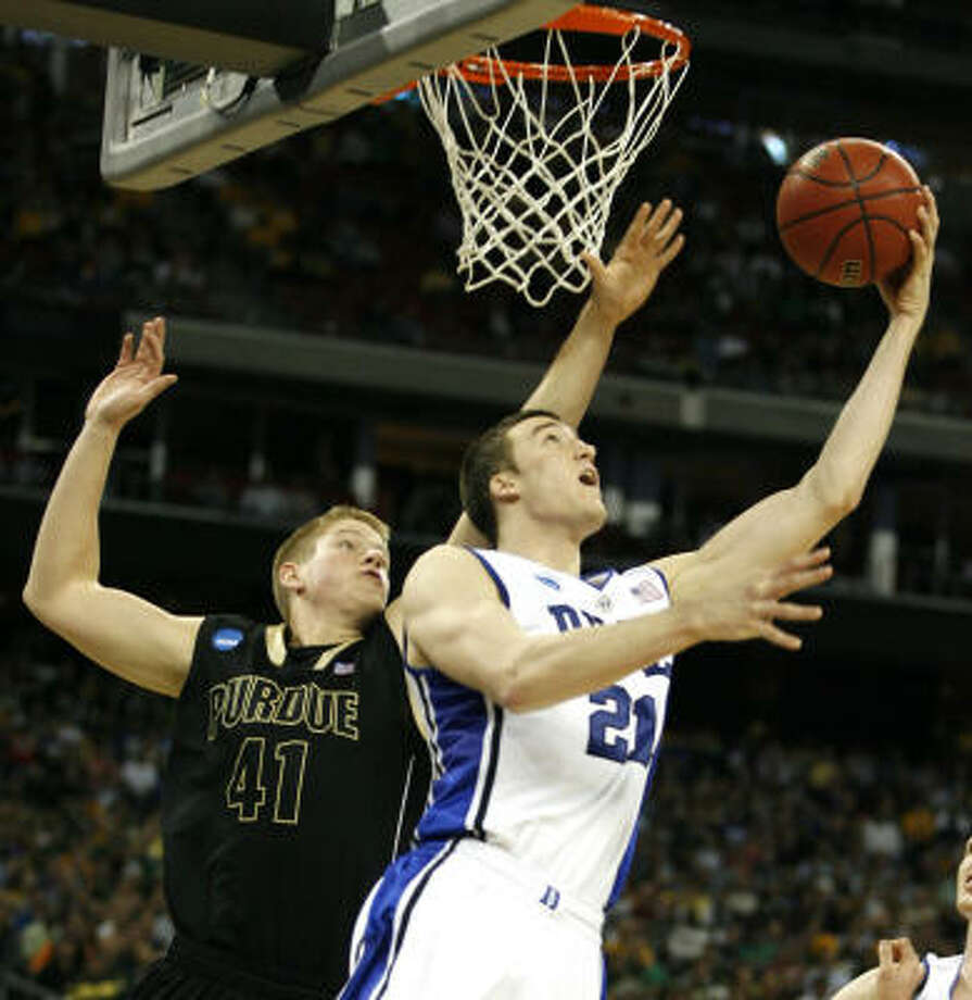 Duke forward Miles Plumlee shoots a reverse layup in front of Purdue forward Patrick Bade. Photo: James Nielsen, Chronicle