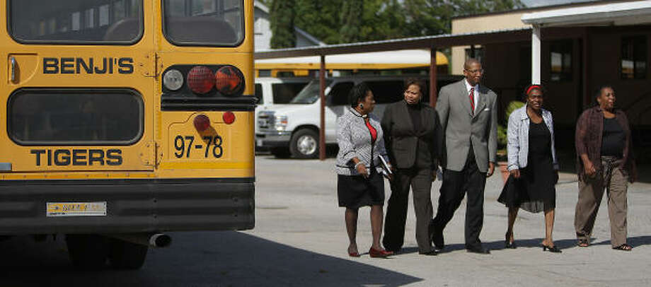 Officials tour Benji's Academy, which opens a new chapter today. Photo: Karen Warren, Chronicle