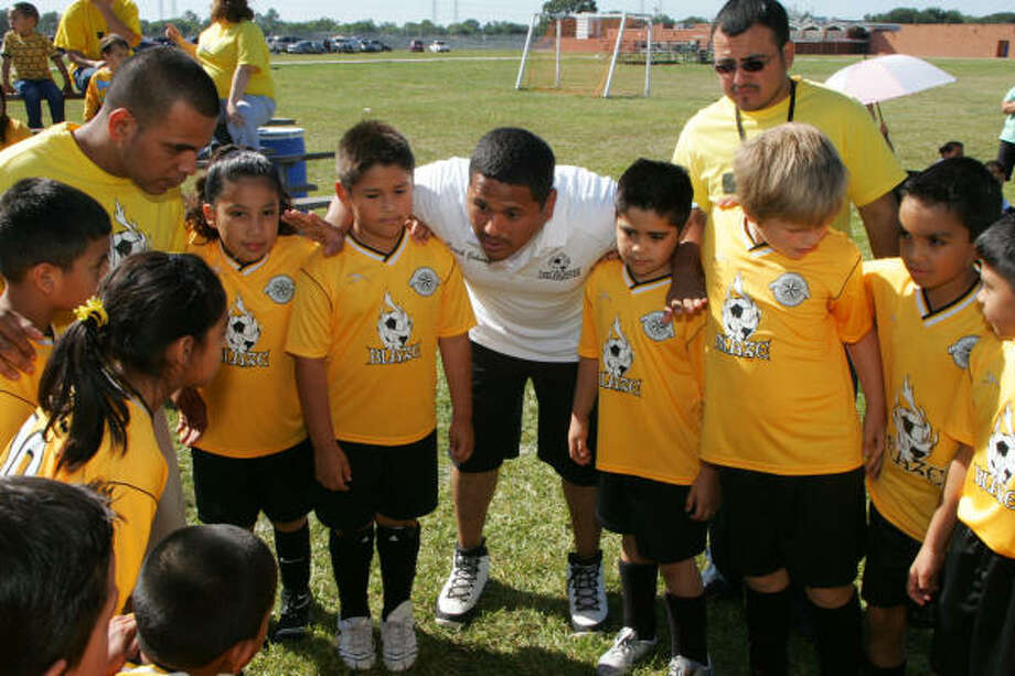 MATTHEW WHITE PHOTOS: FOR THE CHRONICLE POINTERS: The Pasadena Blaze youth soccer team listen as head coach Johnny Gonzales gives them a few last second pointers before a game. Photo: Matthew White, For The Chronicle