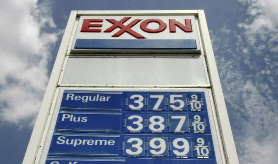 In this July 26, 2011, prices are listed on a marquis at an Exxon station in Greentree, Pa. Oil prices fell to near $94 a barrel Tuesday, Aug. 2, 2011, in Europe as worries over the state of the U.S. economy overshadowed a deal to raise the U.S. debt ceiling, a move that avoids the risk of a debt default.(AP Photo/Gene J. Puskar) Photo: Gene J. Puskar, STF / AP
