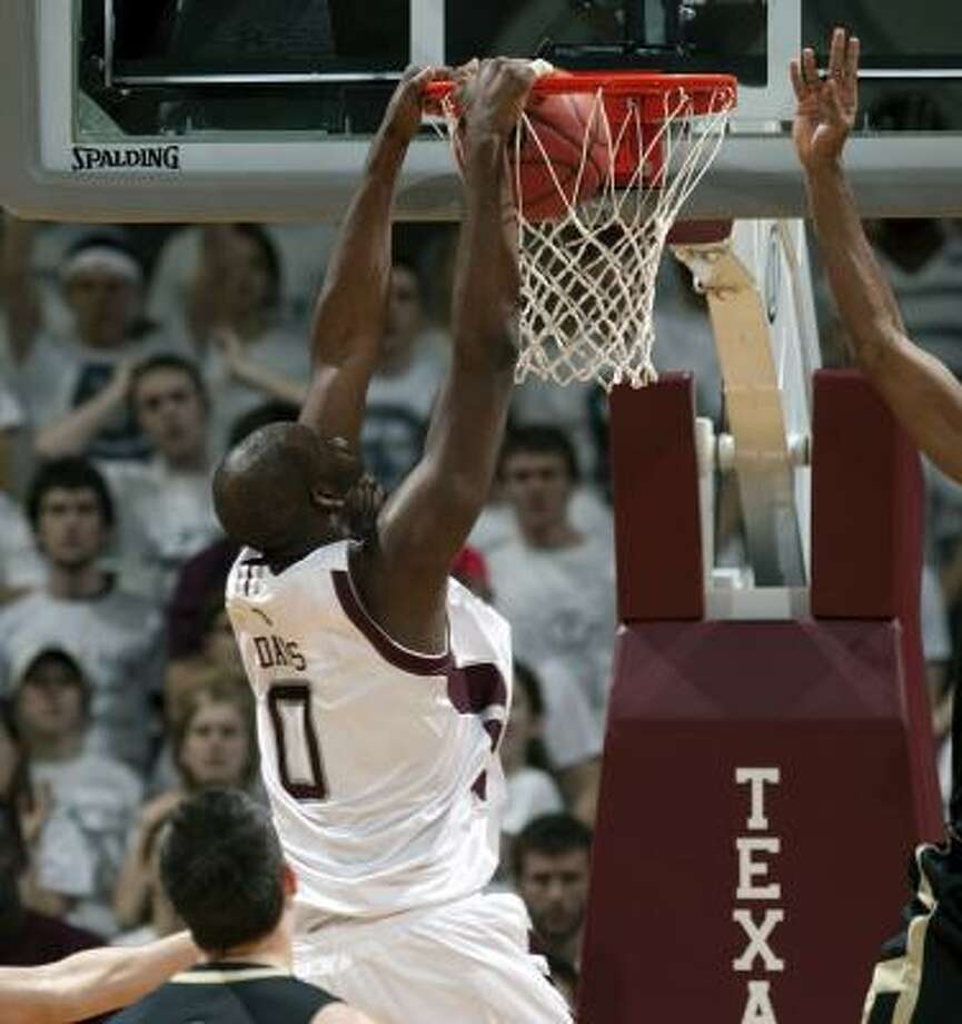 Texas A&M's Bryan Davis dunks the ball in the first half of the Aggies' game against Colorado. Photo: Bob Levey, AP