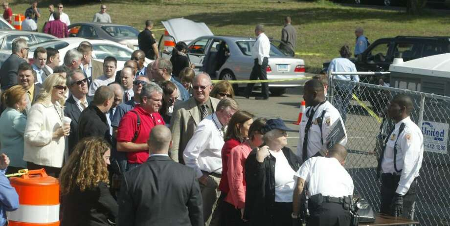 Guests and media wait their turns in the security line, to attend Vice President Joe Biden's visit to the Fairfield Park and Ride on Jefferson Street, Monday, Oct. 5, 2009. Biden was joined by Sen. Chris Dodd and Rep Jim Himes to discuss the Recovery Act investments along the Merrit Parkway. Photo: Phil Noel / Connecticut Post