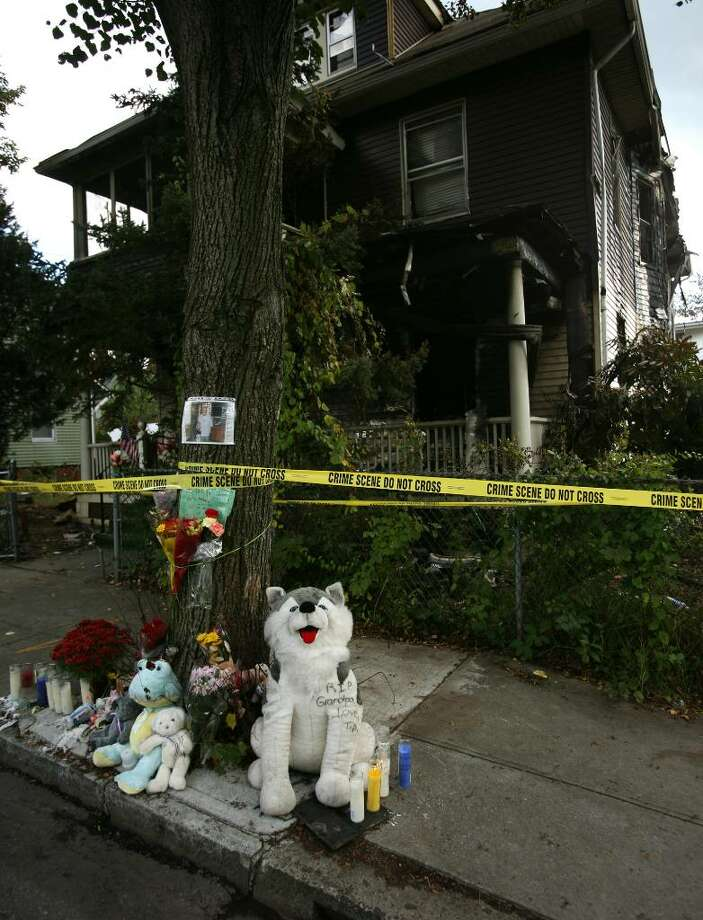 A memorial of stuffed animals, candles, and flowers sits outside his 16 Fifth St. house in Ansonia where Rufus McMichael perished in a fire on Friday night. Photo: Brian A. Pounds / Connecticut Post