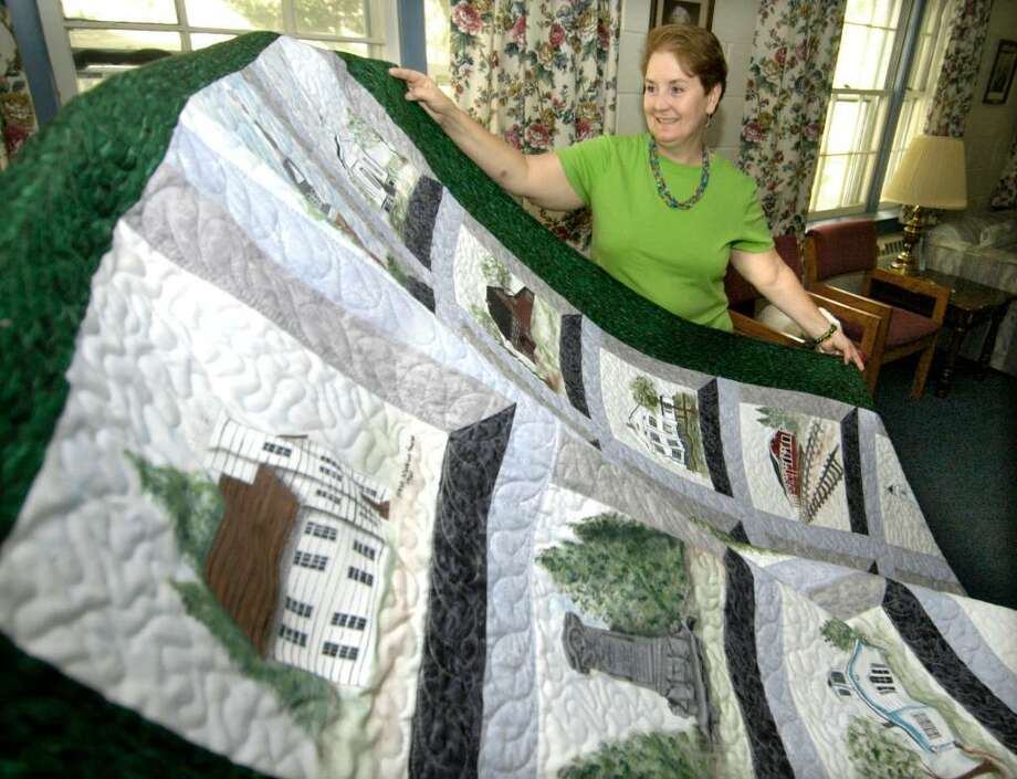 Kristine Beckman, 53, of Newtown with the Bethel historical quilt that she created to commemorate the 250th anniversary of the First Congregational Church of Bethel Monday, Oct. 5, 2009 Photo: Carol Kaliff / The News-Times