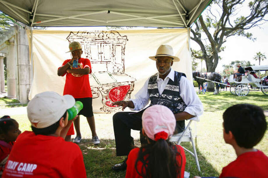David O'Neal portrays Richard Nelson, the first black newspaper editor and publisher in Texas, during a YMCA day camp honoring Juneteenth. Photo: Michael Paulsen, Chronicle
