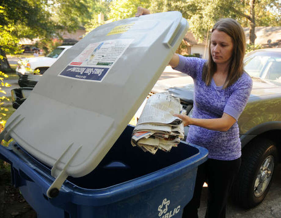 Consumers such as Jennifer Dowdy of Conroe are making recycling a part of their daily lives. Photo: David Hopper, For The Chronicle