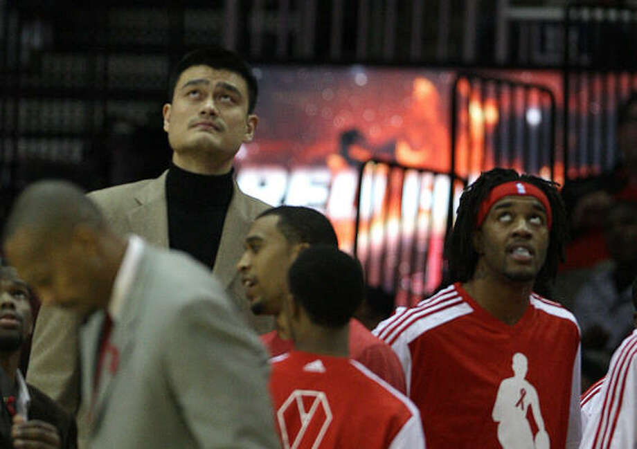 Yao Ming watches during a time out as his teammates beat the Los Angeles Lakers on Wednesday at Toyota Center. Photo: Karen Warren, Chronicle