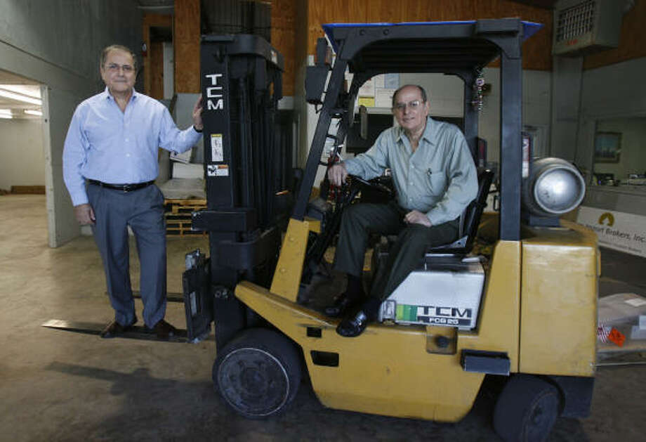 Rod Ulloa, left, and Joe Torres launched Cargo Import Brokers in 1988. Ulloa oversees imports, while Torres handles freight forwarding. Photo: Julio Cortez :, Chronicle