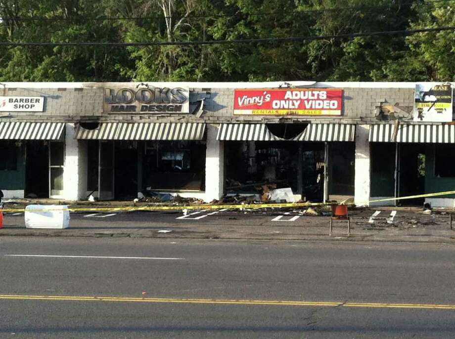 A strip mall on Boston Post Road was gutted by a fire Tuesday, August 2, 2011. Photo: Tom Cleary