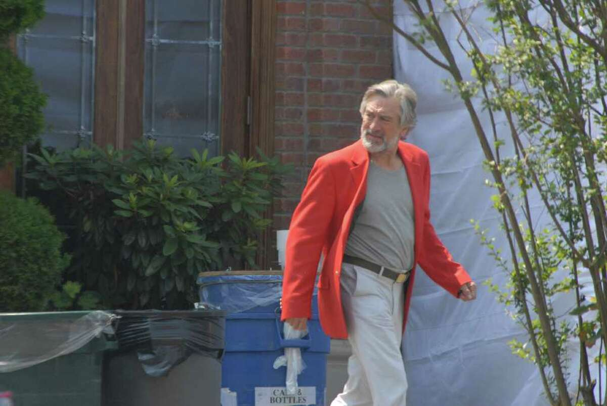 """Actor Robert De Niro walks from the back of Gabriele's Italian Steakhouse on Church Street in Greenwich on Tuesday, Aug. 2, 2011. Scenes from the movie """"The Wedding,"""" starring De Niro, Diane Keaton, Robin Williams, Susan Sarandon, New Canaan native Katherine Heigl and Darien native Topher Grace, were filmed at the restaurant. Photo by John Ferris Robben"""