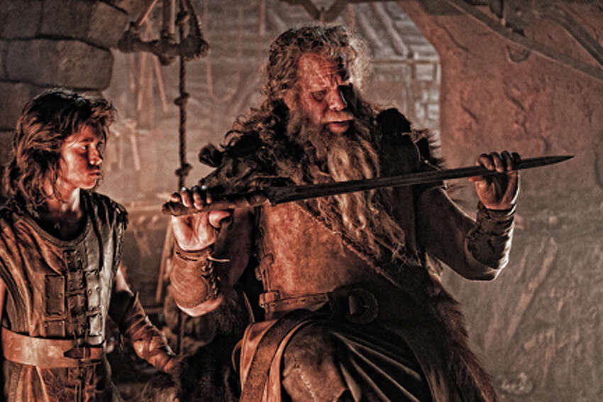 (L-R) Leo Howard as Conan and Ron Perlman as Corin in