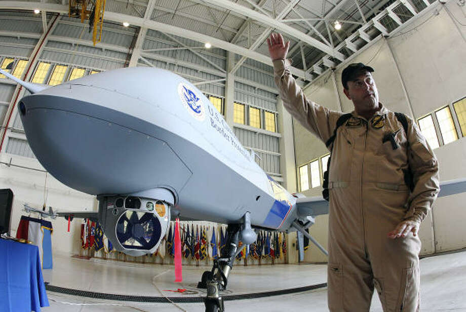 David Gasho, director of operations for the Sierra Vista, Ariz., office of the U.S. Customs and Border Protection agency, talks about the capabilities of the MQ-9 Predator B. Photo: KIN MAN HUI, SAN ANTONIO EXPRESS-NEWS