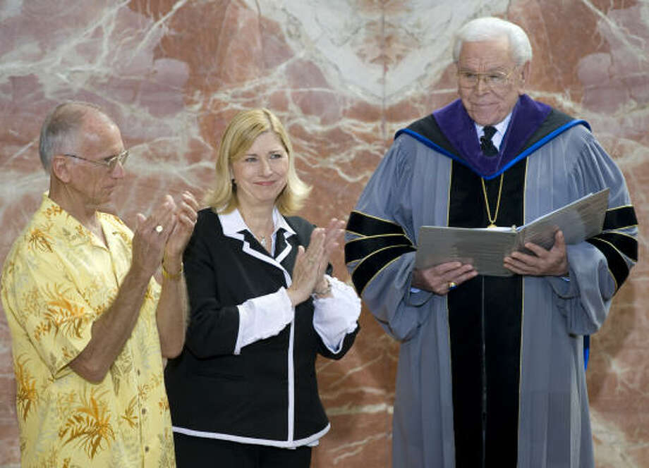 Sheila Schuller Coleman and her husband, Jim, left, share applause with congregants at the Crystal Cathedral last month as her father, the Rev. Robert H. Schuller, names her senior pastor. Photo: JOSHUA SUDOCK, ORANGE COUNTY REGISTER | ASSOCIATED PRESS