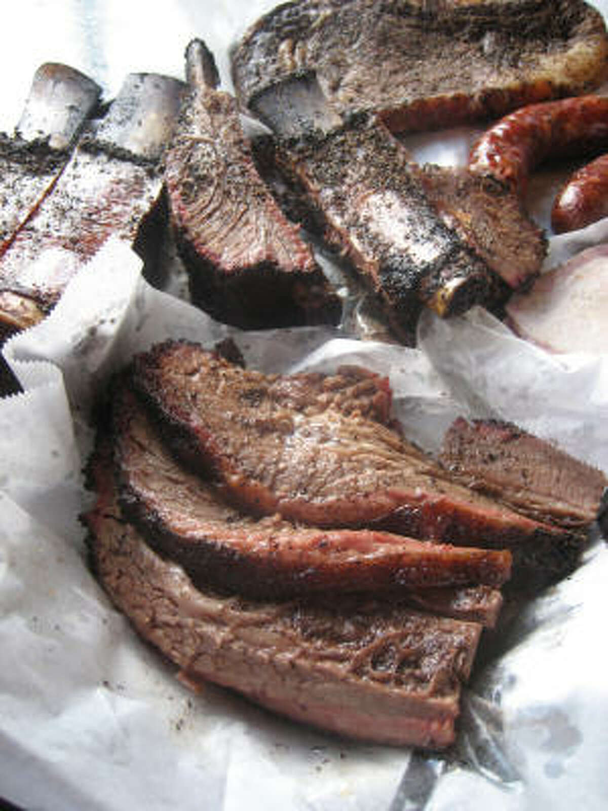 The famous brisket (foreground) from Louie Mueller Barbecue in Taylor.