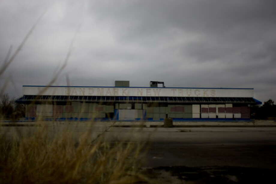Only the barest bones remain of the building that housed Landmark Chevrolet on the North Freeway near West Mount Houston Road. Neighbors say vagrants have taken what they can. Photo: Johnny Hanson, Chronicle