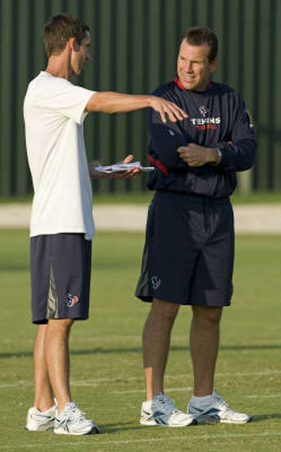 Texans head coach Gary Kubiak, right, wants a smooth transition from Kyle Shanahan, left, to the new offensive coordinator. Photo: Brett Coomer, Chronicle