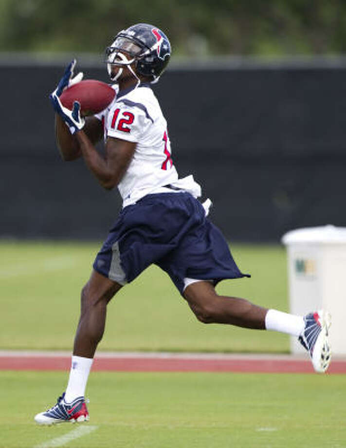 Texans coach Gary Kubiak expects fourth-year receiver Jacoby Jones to compete with Kevin Walter for a starting job. Photo: Brett Coomer, Chronicle