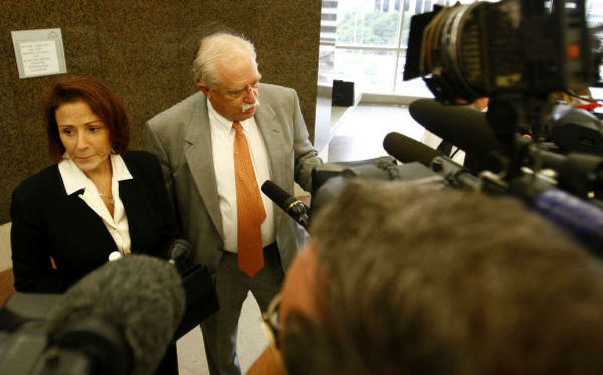 Darla Lexington and her attorney, Jimmy Williamson, confront the media microphones and cameras Friday at the Harris County Civil Courthouse.