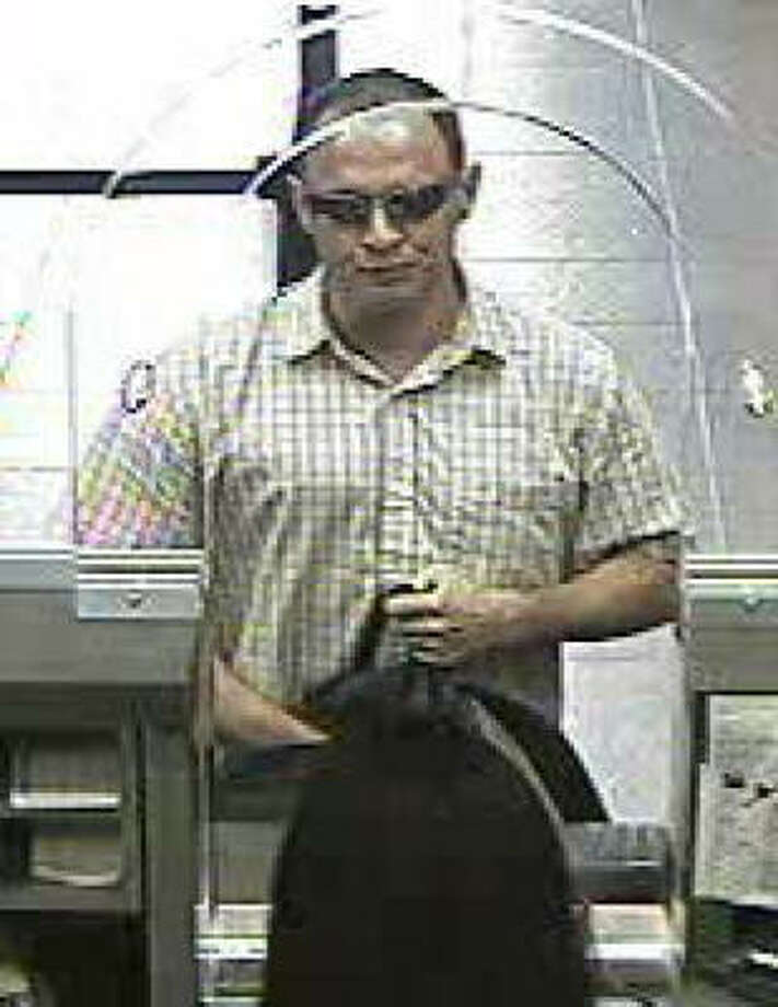 Authorities are looking for this Chase bank robbery suspect, seen on surveillance video. Photo: FBI