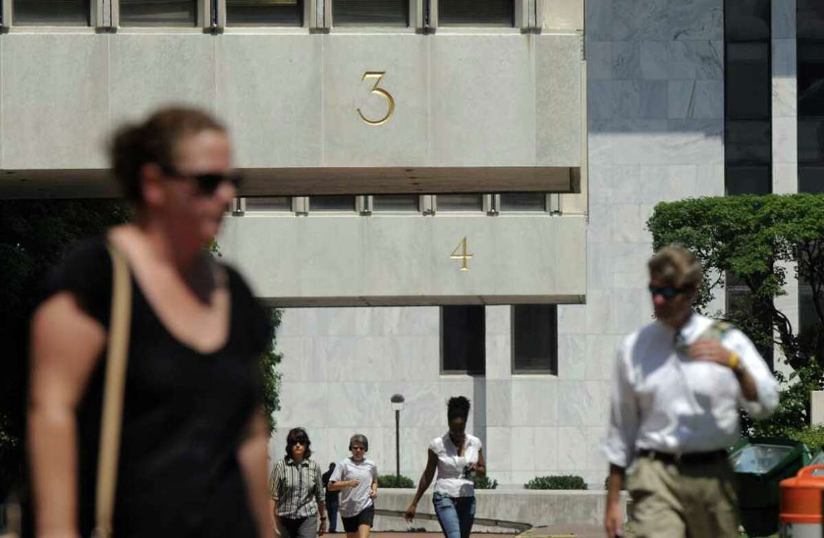 Pedestrians walk past the agency buildings on the Empire State Plaza on Tuesday Aug. 2, 2011 in Albany, NY. (Philip Kamrass / Times Union)